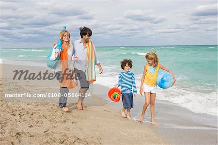 Family enjoying vacations on the beach Stock Photo - Premium Royalty-Free, Image code: 6108-05864164