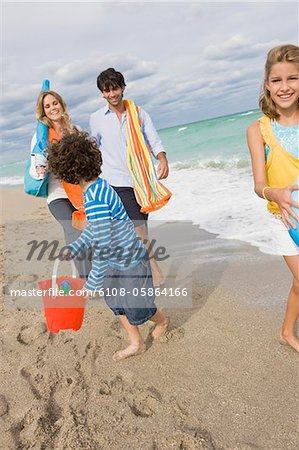 Family enjoying vacations on the beach Stock Photo - Premium Royalty-Free, Image code: 6108-05864166