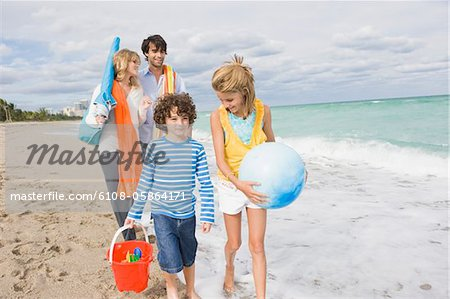Family enjoying vacations on the beach Stock Photo - Premium Royalty-Free, Image code: 6108-05864171