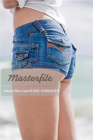 Mid section view of a woman Stock Photo - Premium Royalty-Free, Image code: 6108-05864209