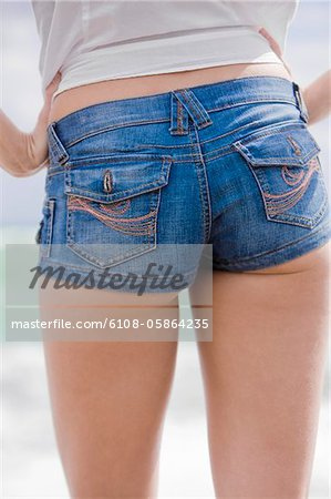 Mid section view of a woman Stock Photo - Premium Royalty-Free, Image code: 6108-05864235