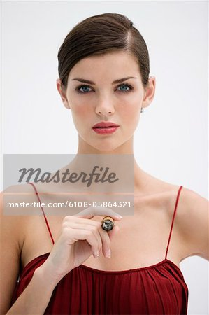 Fashion model smoking a cigar Stock Photo - Premium Royalty-Free, Image code: 6108-05864321