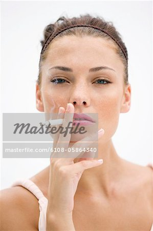 Portrait of a woman smoking a cigarette Stock Photo - Premium Royalty-Free, Image code: 6108-05864340