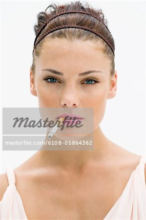 Portrait of a woman smoking a cigarette Stock Photo - Premium Royalty-Free, Image code: 6108-05864362