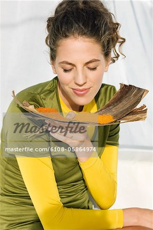 Close-up of a woman smelling spices Stock Photo - Premium Royalty-Free, Image code: 6108-05864974