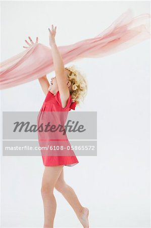 Girl catching a stole Stock Photo - Premium Royalty-Free, Image code: 6108-05865572
