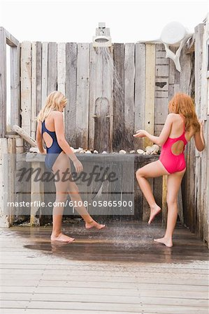 Two girls under a beach shower Stock Photo - Premium Royalty-Free, Image code: 6108-05865900