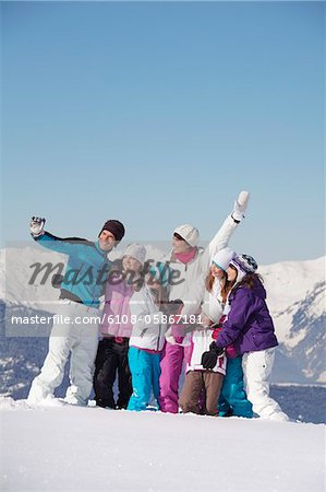 Family taking self portrait in snow Stock Photo - Premium Royalty-Free, Image code: 6108-05867181