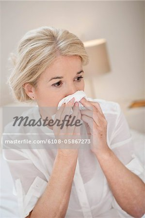 Close-up of a woman suffering from cold Stock Photo - Premium Royalty-Free, Image code: 6108-05867273