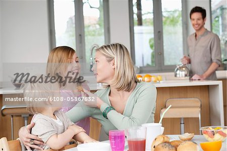 Family at a breakfast table Stock Photo - Premium Royalty-Free, Image code: 6108-05867632