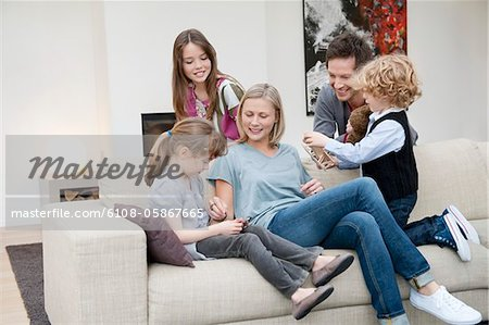 Family in a living room Stock Photo - Premium Royalty-Free, Image code: 6108-05867665