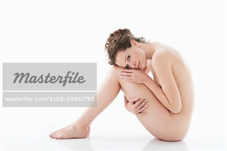 Portrait of a naked woman Stock Photo - Premium Royalty-Free, Image code: 6108-05867793