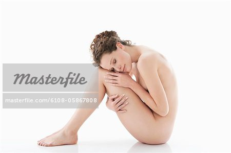 Side profile of a naked woman Stock Photo - Premium Royalty-Free, Image code: 6108-05867808