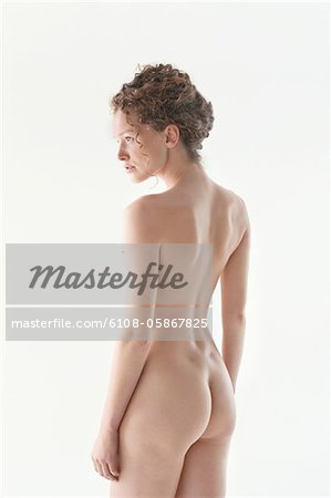 Rear view of a naked woman Stock Photo - Premium Royalty-Free, Image code: 6108-05867825