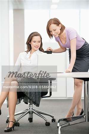 Two businesswomen working in an office Stock Photo - Premium Royalty-Free, Image code: 6108-05868862