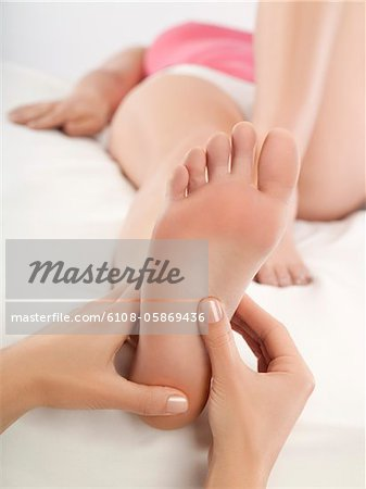 Woman receiving foot massage Stock Photo - Premium Royalty-Free, Image code: 6108-05869436