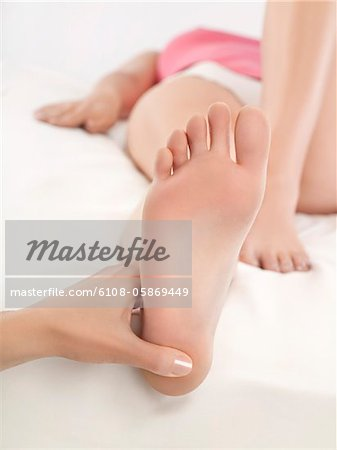Woman receiving foot massage Stock Photo - Premium Royalty-Free, Image code: 6108-05869449