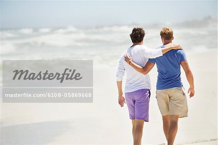 Rear view of two men walking with their arms around each other Stock Photo - Premium Royalty-Free, Image code: 6108-05869668