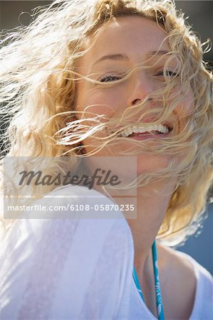 Portrait of a beautiful woman smiling Stock Photo - Premium Royalty-Free, Image code: 6108-05870235