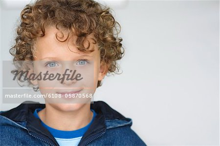 Portrait of a smiling boy Stock Photo - Premium Royalty-Free, Image code: 6108-05870568