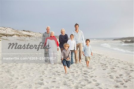 Family enjoying on the beach Stock Photo - Premium Royalty-Free, Image code: 6108-05870817