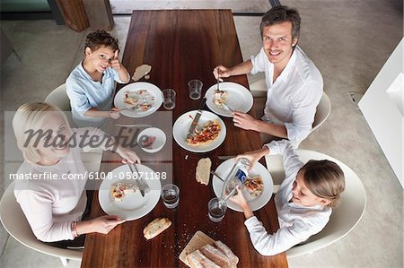 Family having food together Stock Photo - Premium Royalty-Free, Image code: 6108-05871188