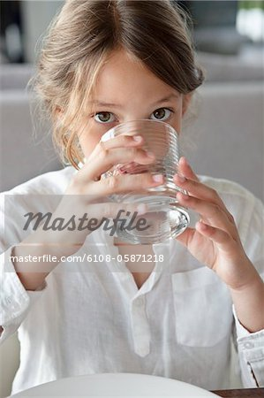 Portrait of a girl drinking water Stock Photo - Premium Royalty-Free, Image code: 6108-05871218