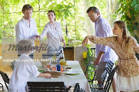 Family preparing for food at house Stock Photo - Premium Royalty-Free, Image code: 6108-05871967