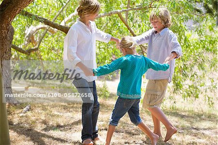 Little children playing outdoors Stock Photo - Premium Royalty-Free, Image code: 6108-05872658