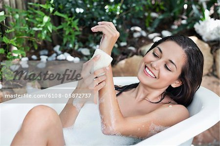 Beautiful young woman taking bubble bath Stock Photo - Premium Royalty-Free, Image code: 6108-05872737