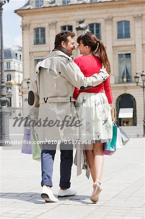 Couple walking on a street, Paris, Ile-de-France, France Stock Photo - Premium Royalty-Free, Image code: 6108-05872858