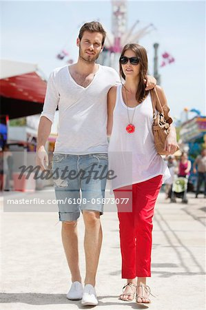 Couple walking in amusement park, Jardin des Tuileries, Paris, Ile-de-France, France Stock Photo - Premium Royalty-Free, Image code: 6108-05873077