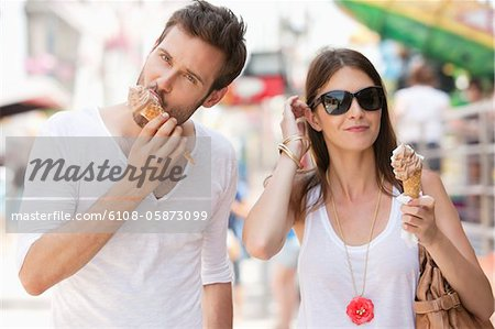 Couple eating ice creams, Paris, Ile-de-France, France Stock Photo - Premium Royalty-Free, Image code: 6108-05873099
