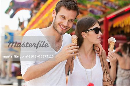 Couple eating ice creams, Paris, Ile-de-France, France Stock Photo - Premium Royalty-Free, Image code: 6108-05873116