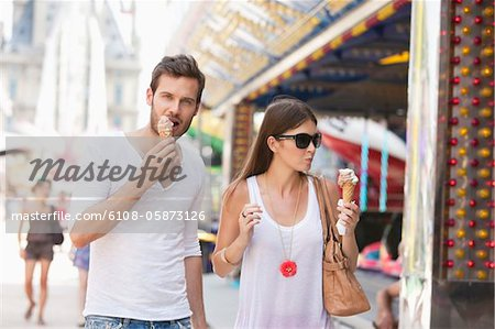 Couple eating ice creams, Paris, Ile-de-France, France Stock Photo - Premium Royalty-Free, Image code: 6108-05873126