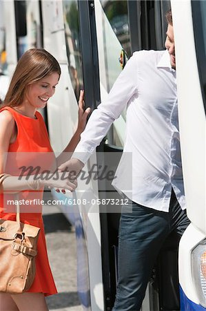 Couple boarding in a bus, Paris, Ile-de-France, France Stock Photo - Premium Royalty-Free, Image code: 6108-05873212