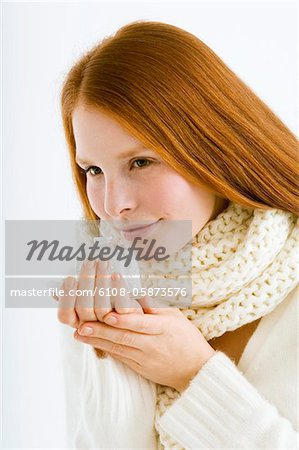 Close-up of a young woman smelling perfume from a bottle Stock Photo - Premium Royalty-Free, Image code: 6108-05873576