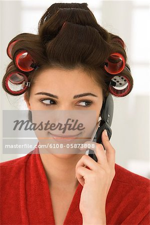 Woman talking on a mobile phone Stock Photo - Premium Royalty-Free, Image code: 6108-05873808