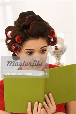 Close-up of a woman reading a book Stock Photo - Premium Royalty-Free, Image code: 6108-05873811