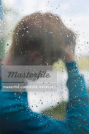 Man behind a glass Stock Photo - Premium Royalty-Free, Image code: 6108-06165981