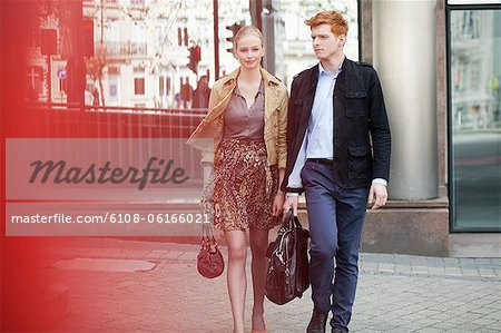 Couple walking on a footpath Stock Photo - Premium Royalty-Free, Image code: 6108-06166021