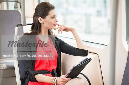 Woman traveling in a bus and thinking Stock Photo - Premium Royalty-Free, Image code: 6108-06166140