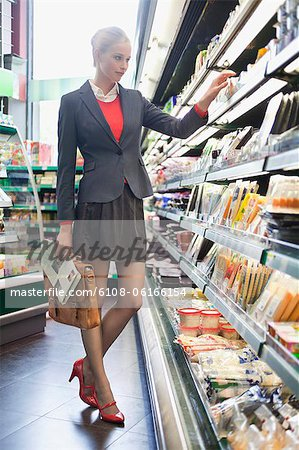 Woman shopping in a supermarket Stock Photo - Premium Royalty-Free, Image code: 6108-06166154