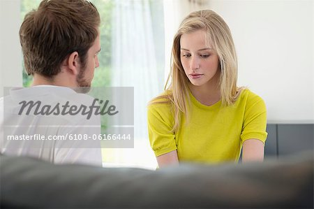 Couple sitting together Stock Photo - Premium Royalty-Free, Image code: 6108-06166444