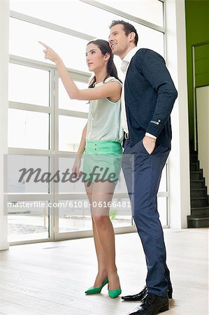 Couple looking for a new house Stock Photo - Premium Royalty-Free, Image code: 6108-06166481