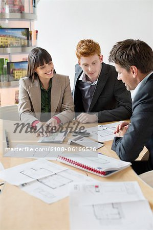 Real estate agent discussing property documents to his clients Stock Photo - Premium Royalty-Free, Image code: 6108-06166526