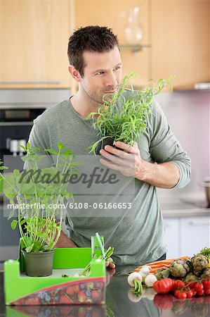 Man preparing food in the kitchen Stock Photo - Premium Royalty-Free, Image code: 6108-06166653
