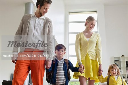 Couple with their children Stock Photo - Premium Royalty-Free, Image code: 6108-06166809