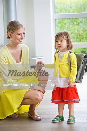 Little girl getting ready for school Stock Photo - Premium Royalty-Free, Image code: 6108-06166814