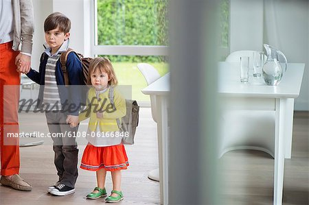 Children with their father leaving for school Stock Photo - Premium Royalty-Free, Image code: 6108-06166848